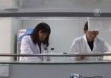 Китайские вирусологи в лаборатории. Кадр NTDTV
