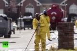 Рабочие убирают нефть с улиц Мэйфлауэра, штат Арканзас, США. Кадр RT