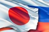 Флаги России и Японии. Коллаж: obozrevatel.com