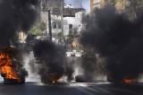 """Демонстранты в знак протеста против """"Братьев-мусульман"""" подожгли покрышки в Луксоре, Египет. Фото: SANA"""