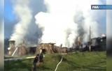 Тушение пожара в Новгородском интернате Оксочи. Кадр РИА Новости