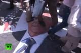 Иранцы топчут портрет Обамы в знак протеста против политики США. Кадр RT