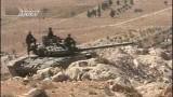 Сирийские военные на танке. Фото: ANNA-News