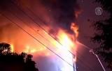 В китайском городе Гуанчжоу сгорел небоскрёб. Кадр NTDTV