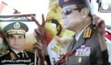 Плакаты с фото маршала и министра обороны ЕгиптаАбделя Фатаха ас-Сиси. Кадр Euronews