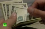 Доллары. Кадр RT